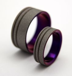 Blast off. A sandblasted finish and anodized purple interior add a whole new dimension to our Double Offset Pinstripe band. Pictured at 6.4mm and 7.9mm.