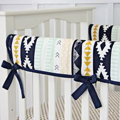 This crib rail cover features an Aztec design for a unique baby crib bedding. It matches the Aztec Gold and Mint Bumperless baby crib bedding. Caden Lane, Jack and Jill Boutique