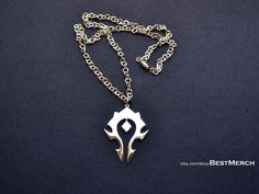 World of Warcraft WOW Logo Horde Pendant. This one is pretty.