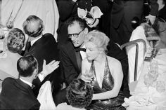 Playwright Arthur Miller (C) and actress wife Marilyn Monroe attending the  April in Paris Ball at the Waldorf Astoria Hotel.