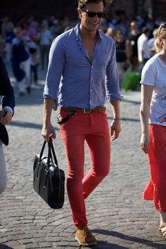 red pants, blue shirt & leather bag