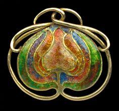 Arts & Crafts Brooch    Gold & enamel Height: 2.5 cm (1 in)   Width: 2.8 cm (1.1 in)  British. Circa 1900