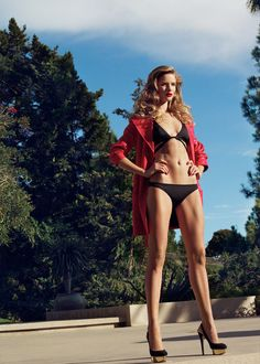 Rosie Huntington-Whiteley luxuriates poolside for the January cover shoot of Harper's Bazaar UK lensed by Tom Munro. A vision in swimwear and form-fitting dresses styled by Cathy Kasterine, Rosie soaks up the sun with red lips by Pati Dubroff and lush curls by Ben Skervin.    Heels, Bikini, Red, Black, Gold, Blonde