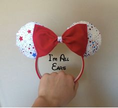 These HANDMADE Fourth of July Inspired Mouse ears are perfect for the summer holiday or even your magical trip to theme parks, conventions, and more! These mouse ears are made to fit and be worn by all ages. Price: $20.20