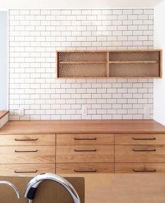 oguma LLCさんはInstagramを利用しています:「滋賀県のお宅の食器棚。 ・ 木材は栗。 栗は使い込むほどに深い色味になります。 吊り戸棚の引き戸はガラス。 ・ 壁面には白いタイルを。キッチンのポイントにもなり、明るくなります。 ・ コンセントの位置もカップボードに合わせました。 ・ …………………………………………………」