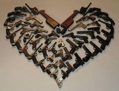 This was sent to me via FB, nothing says love like a gun, or in this case, several guns, lol (source unk.)