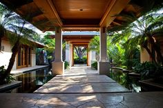 Private Hawaiian Residence, home with water feature for entry, tropical foliage, palms, flagstone patio/ entry, lgordonlandarch.com