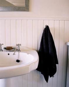 Although tile walls in a bathroom are functional, they often leave a lot to be desired aesthetically. Installing wainscoting, especially waterproof beadboard, can give the space the designer look you ...