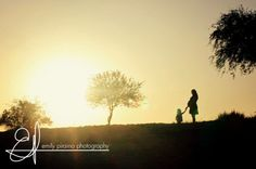 Amazing sunset photo of mom and daughter.  Maternity shot.  family photo.