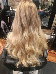 Long layers, blonde hair, baby lights