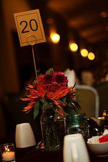 Wedding flower centerpieces in mason jars.