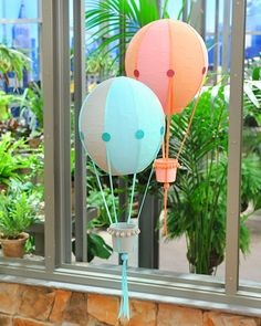 Papier Mache Hot Air Balloons. I like them best when decorated using colored tissue paper (as opposed to paint) and when there isn't a big concern over lines being straight! Strawberry baskets are great to use for the balloon's basket. So cute!*** adorable in kids room