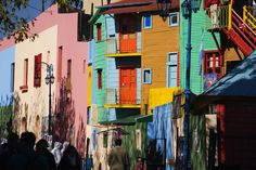 Make the trip to La Boca for the colourful houses, street performers and tango