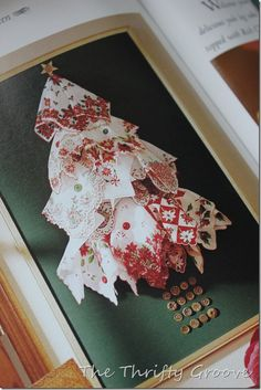Framed Christmas hankies in the shape of a tree.
