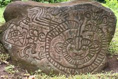 Snake-like petroglyphs on a rock on Ometepe island, an island formed by two volcanoes in Lake Nicaragua, Republic of Nicaragua.