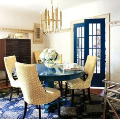 We want a round pedestal table and 4 chairs covered in modern fabric for our tiny dining room.