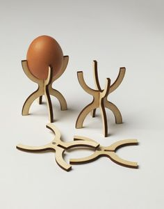 This egg cup is made from laser-cut Birch-ply. It comes in two parts and  is self assembled. Each piece contains a magnet so that they can be stored on the fridge when not being used. Each end is a different size to fit either a medium or large egg.