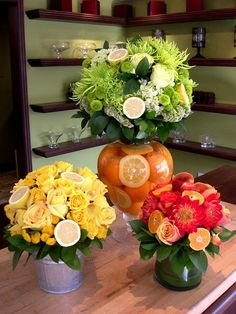 Creative use of flowers & fruit together. I have seen fruit used many times to line vases but to step out & include the fruit in the arrangement gives it a fresh look plus would put off a lovely aroma mixed with the florals. Fruit Centerpieces, Fruit Arrangements, Flower Arrangement, Deco Floral, Floral Design, Flower Decorations, Table Decorations, Fruit Flowers, Yellow Flowers