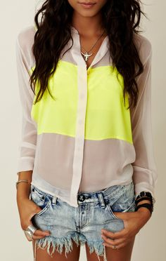 Wear a sheer & neon colorblock blouse with denim cutoffs for an easy yet super chic look.