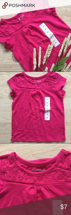 NWT Cat & Jack Eyelet Tee Shirt Cute tee shirt with eyelet details along neckline. The brand has been crossed out; it does not have swing tag but size sticker is still on. Cute for Valentine's Day or spring! 💗Bundle to save; reasonable offers welcome ✨ 2 sizes available--the 18 MO size has a light mark on the neck where the brand was crossed out; the 2T does not. Cat & Jack  Shirts & Tops Tees - Short Sleeve