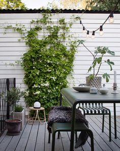 Home tour: Janniche Bergstrom — 91 Magazine - lovely outside space in scandi style with garden furniture and festoon lighting