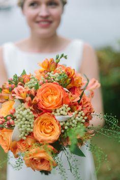 Bright orange bouquet | Photography: Rupert Whiteley - www.rupertwhiteley.com/
