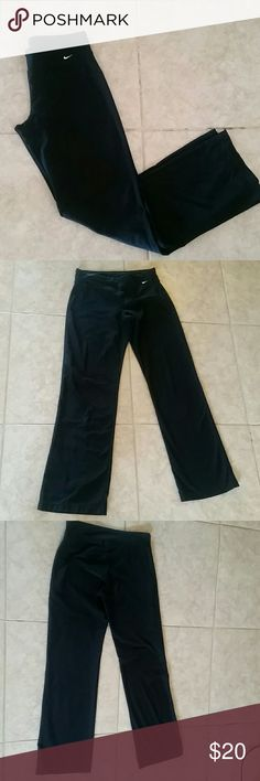 Nike dri fit pants Nike long bootcut dri-fit Athletic training pants, tag is missing, they are med, slim fit on hips and thighs, compression material, slightly flared leg, pull on, nylon spandex high rise, these are used, in excellent condition Nike Pants Track Pants & Joggers