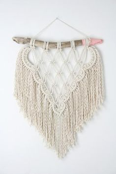MADE TO ORDER hand knotted macrame wall hanging. Each piece of driftwood is unique so your piece will be similar to the one in the picture but not identical. Made with natural undyed cotton rope on found driftwood. Driftwood can be plain or hand-painted in coral (please choose option at checkout) Driftwood width: 15 - 17 inches approximately Length from driftwood to bottom: 19 inches approximately Length from nail to bottom: 24 inches approximately This macrame piece is made to order. Please…