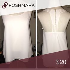 Selling this White Zipperback Blouse Tank in my Poshmark closet! My username is: hperry13. #shopmycloset #poshmark #fashion #shopping #style #forsale #Naked Zebra #Tops