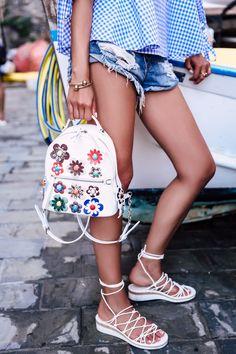 Fendi floral backpack + J.W. Anderson bracelet
