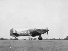 Hawker Hurricane Mk I, P2923, VY-R, flown by Pilot Officer A G Lewis of No. 85 Squadron, landing at Castle Camps, RAF Debden's satellite airfield, July 1940. (See also HU 57626 and HU 57627). This aircraft was lost in action on 25 August 1940