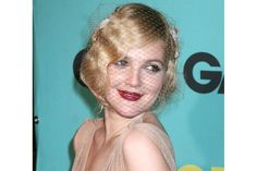 This chic look suits Drew Barrymore so well. It's no wonder she doesn't wear it more often. We also love the birdcage she chose to accent her golden tucked locks.   - Cosmopolitan.com