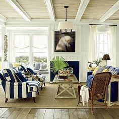 like the ceiling treatment-- white beams with natural bamboo or woven grass texture between