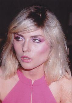 Deborah Harry - very long sideswept fringe with long shaggy bob. Low forehead…