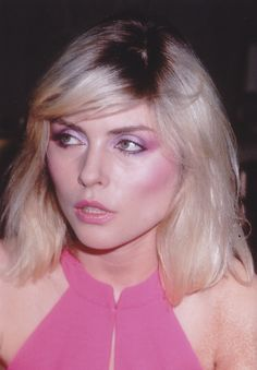 Deborah Harry - very long sideswept fringe with long shaggy bob. Low forehead, wide boxy or heart shaped face.