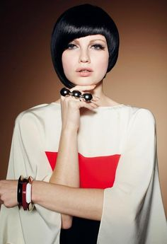 Asymmetrical bob haircut with blunt bangs.