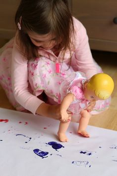 Painting With Dolls by notimeforflashcards: Kids love to walk the babies on the paper and then be mama and clean and wash the feet. #Activity #Toddlers