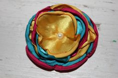 hand sewn hand singed satin rose can be mounted on a pin back, headband or lined alligator clip 1 available