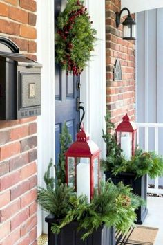 Ideas for easy Christmas porch decor. Winter planter idea using red lanterns. Fe… Ideas for easy Christmas porch decor. Winter planter idea using red lanterns. Festive Christmas wreath along with a cozy Christmas sitting area. Deco Noel Nature, Winter Planter, Indoor Christmas Decorations, Outdoor Decorations, Front Porch Ideas For Christmas, Outdoor Christmas Wreaths, Decorating For Christmas Outdoors, Winter Porch Decorations, Lantern Christmas Decor
