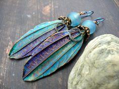 A Flash of Blue Sky - wearable art polymer clay aqua midnight blue bronze lampwork rustic leaf earrings. by PreciousViolet on Etsy