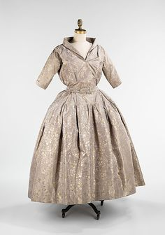 Dinner ensemble  House of Dior  (French, founded 1947)    Designer:      Christian Dior (French, Granville 1905–1957 Montecatini)  Date:      fall/winter 1949–50  Culture:      French  Medium:      silk