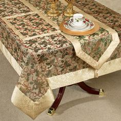 Decorate your holiday table with the festive Holly Ribbon Table Accessories. Pretty, polyester Christmas accents feature a sheer gold fabric center decorated. Coffee Table Runner, Table Runners, Christmas Placemats, Christmas Decor, Christmas Ideas, Tablecloth Fabric, Tablecloths, Oak Table, Gold Fabric