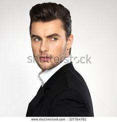 Closeup face of a fashion young businessman in black suit casual  poses at studio by Valua Vitaly, via Shutterstock