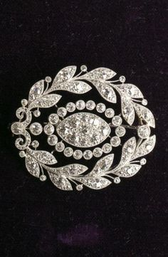 A Belle Epoque platinum, 14k gold and diamond wreath brooch, circa 1915.