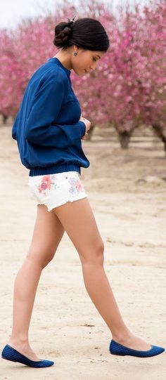Shop this look for $92:  http://lookastic.com/women/looks/blue-crew-neck-sweater-and-white-denim-shorts-and-navy-ballerina-shoes/1644  — Blue Crew-neck Sweater  — White Floral Denim Shorts  — Navy Polka Dot Ballerina Shoes