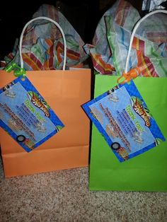 Hot wheels party favor bags with thank you attached.