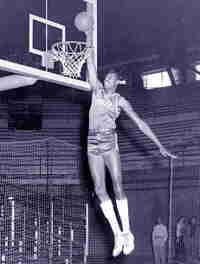 """Wilt Chamberlain's phenomenal success as a basketball player at the University of Kansas forced the NCAA to make several rule changes to help """"level the playing field."""""""