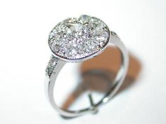 Bague ronde or blanc diamants