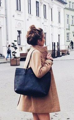 The camel coat is this season must have.