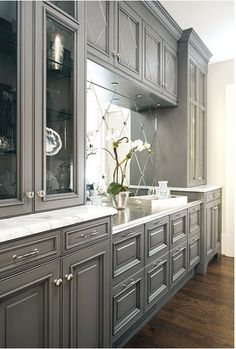 beautiful gray cabinets-- would be fun to re-finish bathroom cabinets with this.